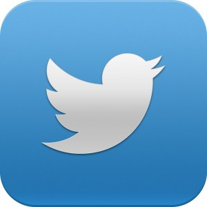 silver outline of a tweeting bird with a blue gradient background.
